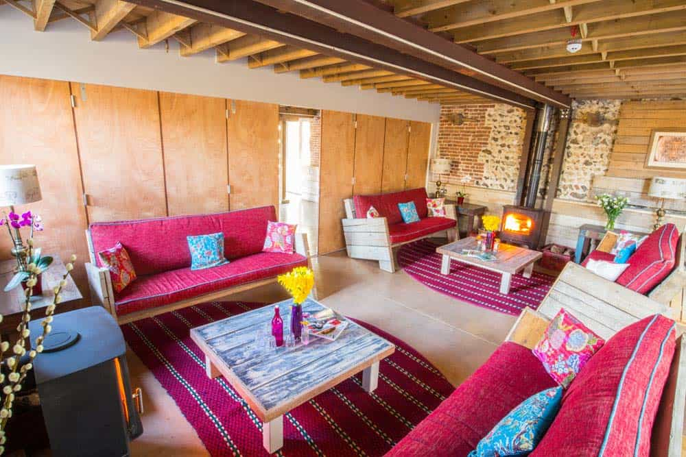 living area red sofas wood burner norfolk yoga retreat