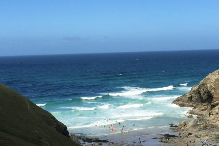 St Agnes beach cornwall bay and sea with waves and people in sea