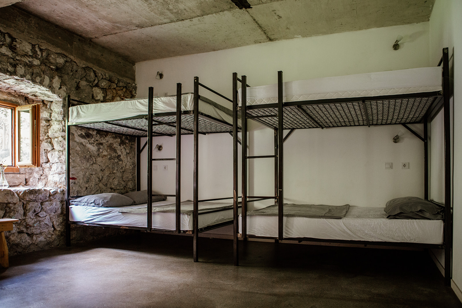 two double bunk beds against wall - hiking yoga holiday montenegro