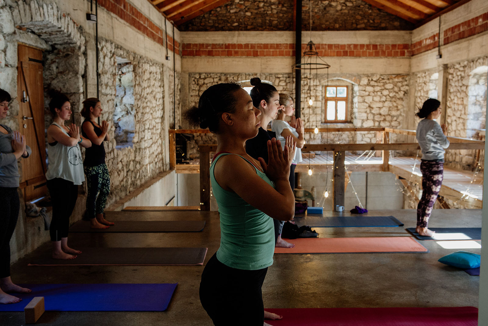 tadasana hands in prayer in yoga space - yoga holiday montenegro