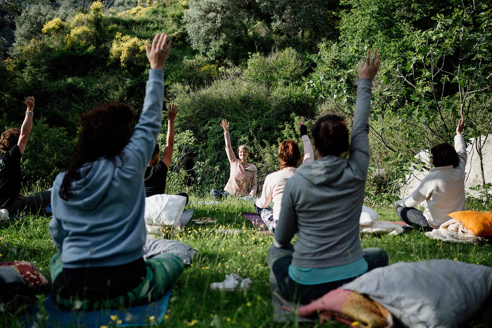 seated yoga outside on grass - hiking yoga holiday montenegro