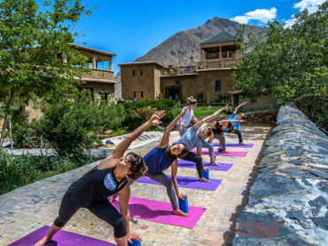 outdoor yoga class atlas mountains morocco
