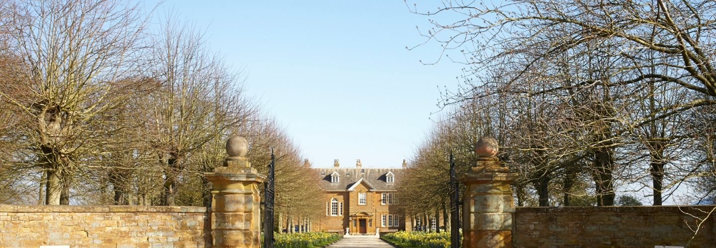oxford venue in distance down wintery tree lined stone driveway