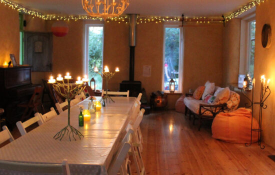 long table, candles, seating area straw bale barn